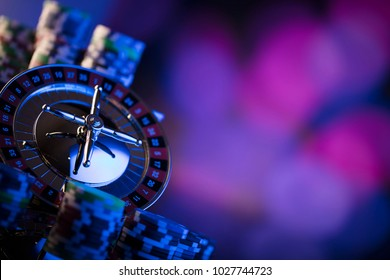 Casino. High contrast image of casino roulette. Poker chips. Bokeh background