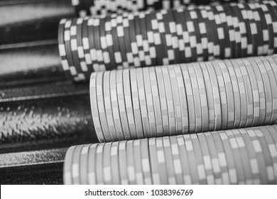 Casino / poker chips colorful gaming pieces lie on the game table in the stack. Background for gambling / casino, business, poker. many colorful casino chips. black and white photography. Soft focus