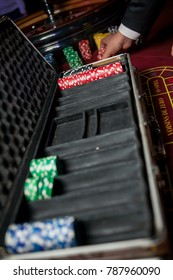 Casino / poker chips colorful gaming pieces lie on the game table in the stack. Background for gambling / casino, business, poker. Colorful casino / poker chips for casino game on the table.Soft focus