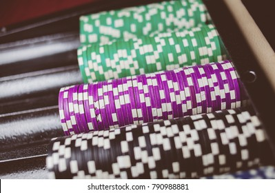 Casino / poker chips colorful gaming pieces lie on the game table in the stack.