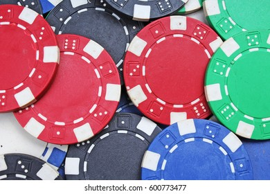 Casino poker money chips texture. Stack of poker chips as background.