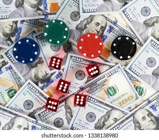 Casino red dices US Dollar bills background casino poker chips