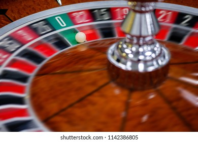 Casino roulette wheel and it's numbers in red and black color
