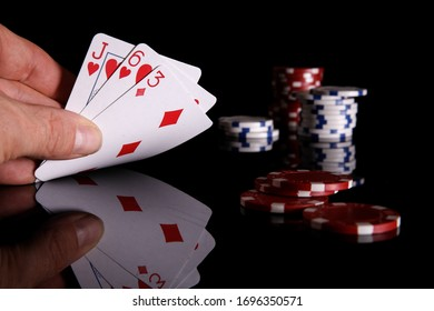 casino ships and poker card  isolated on black background.