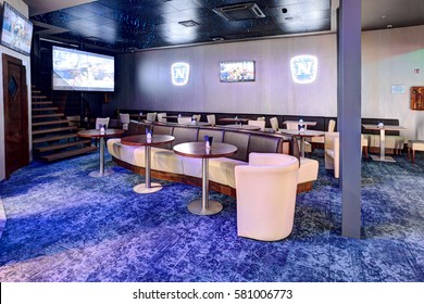 CASINO & SPORT BAR ADMIRAL, LITHUANIA - 09 FEBRUARY 2017: Interior of casino Admiral. Bar and TV screen lounge. Klaipeda, Lithuania.