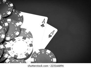 Casino table with a pair of aces and chips