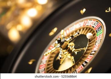 Casino theme. Golden roulette wheel closeup.