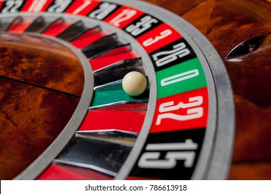 Casino theme. image of casino roulette, poker game. the drum from roulette. that our life-game. Luxury roulette in a casino. roulette wheel and the ball in the winning number zero. close up image