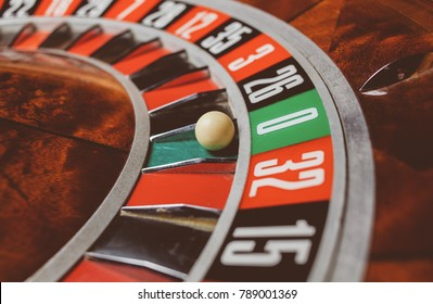 Casino theme. image of casino roulette, poker game. the drum from roulette. that our life-game. Luxury roulette wheel and the ball in the winning number zero. close up image. Vintage photo processing