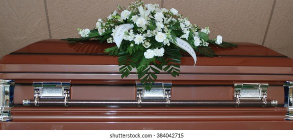 Casket at a funeral service outdoors.