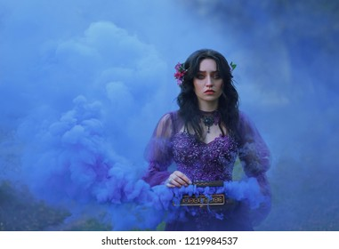Casket Padora. Sad girl holds the evil gift of the gods - a box that is filled with evil. A woman cries that she could not contain her curiosity and released trouble. Background blue smoke.