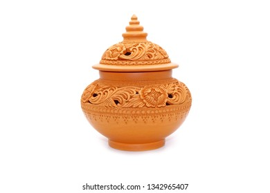 Casket : Thai traditional earthenware casket Isolated on white background. Beautiful Flowers carved earthenware from Thailand. Handmade pottery caskets for keep scented flowers and perfumes.