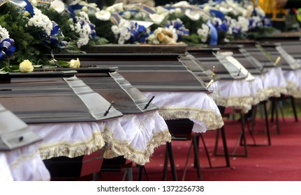 Caskets lined during memorial service before funeral