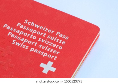 Caslano, Ticino, Switzerland - 2nd August 2019 - Close up view of one Swiss passport on a white background