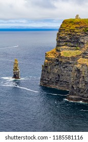 Caslte tower and rocks in Cliffs of Moher, Doolin, Clare, Ireland