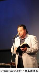 CASPER, WY__CIRCA JUNE 29, 2013__Minister and musician Blaine Bowman preaching a sermon  in Casper, Wy, circa June, 29, 2013.