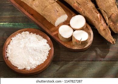Cassava - Manihot esculenta. Wooden background