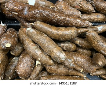 Cassava or Tapioca tubers for sale in a grocery store market