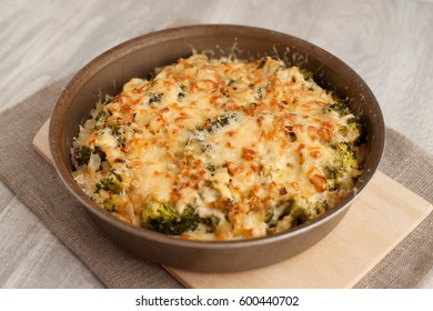 Casserole from broccoli and chicken fillet. The casserole is made from chicken breast, broccoli cabbage, onion, sauce, grated cheese. Chicken fillet is rich in protein. Foam for sports nutrition.