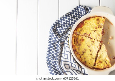 Casserole of cottage cheese with dates on a white wooden background, sugar-free, horizontal, soft focus, top view