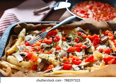 casserole of macaroni with meat and tomatoes and mushrooms