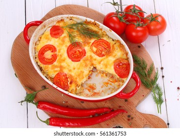 Casserole with minced meat , fresh tomatoes and cheese