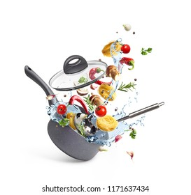 Casserole with pasta and mushrooms with vegetables and water splash, levitation, isolated on white background