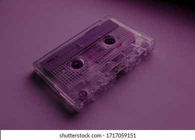 a cassette on purple background