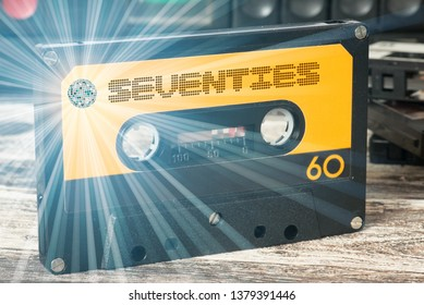 A cassette recorder and a cassette with the music of the seventies