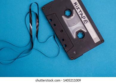 cassette tape isolated against blue background