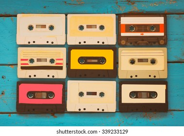 Cassette tapes over blue textured wooden table . top view. retro filter