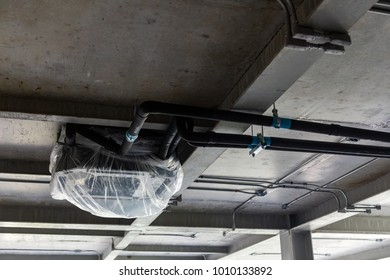 Cassette type air condition and hvac system under bare skin ceiling covered by plastic sheet. Shoot in under-construction site.