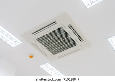 Cassette type air condition with lighting and fire protection system installation on ceiling.