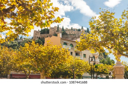 CASSIS, FRANCE - OCTOBER 10, 2009: Low angle view on Chateau de Cassis castle on top of hill behind bright yellow autumn trees