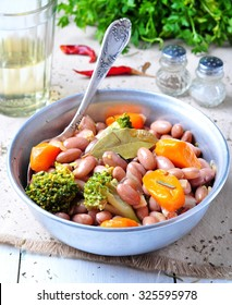 Cassoulet beans, onions, bacon, carrots, broccoli, rosemary and parsley