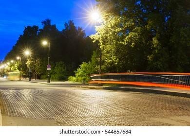 cast iron bridge on Penkovy bridge through a bypass channel at night in Kronstadt. Saint-Petersburg, Russia