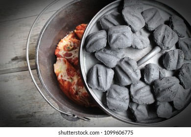 Cast Iron Dutch Oven Stuffed Shells With Charcoal Briquettes