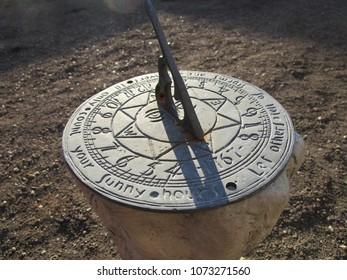 Cast iron garden ornament sundial in natural sunlight
