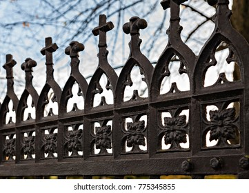 Cast iron gate with crosses.