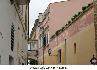 Cast iron grills and lanterns on narrow street of Nardo, Puglia, Italy