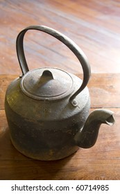 Cast iron kettle over wooden table