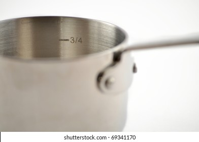 Cast iron measuring cup on a white background