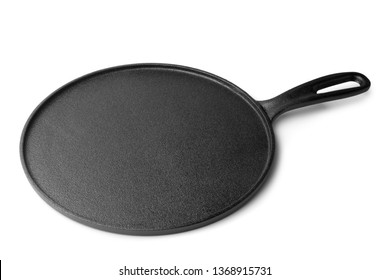 Cast iron pan for baking pancakes on white background