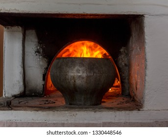 Cast iron pot in the Russian oven. Leningrad region. Russia