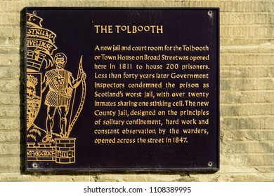 A cast iron sign on the Tolbooth in Stirling.  The Tolbooth was a county jail.