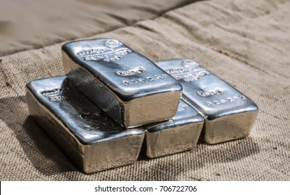 Cast silver bars against the background of the texture of. Selective focus.