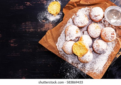 Castagnole - carnival italian fritters on a black wooden board. Top view. with free text space.