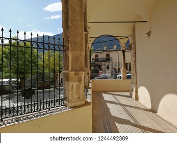 Castel di Sangro, L'Aquila, Abruzzo, Italy - September 1, 2018: View of the portico of the Basilica of Santa Maria Assunta illuminated by the afternoon sun