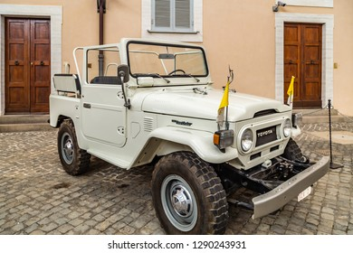 CASTEL GANDOLFO (ROME), ITALY - JANUARY 3, 2019: flags waving on old Popemobiles, cars of past Popes