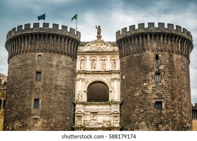Castel Nuovo or New Castle, residence of the medieval kings of Naples, Italy. It is one of the main landmarks of Naples or Napoli. Old castle with powerful towers and luxury decoration of the gate.